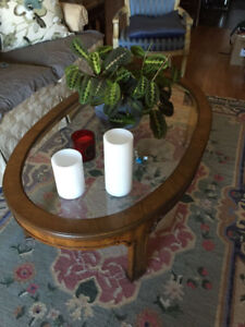Solid wood and glass coffee table.