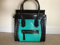 Large stylish handbag in black and bright green, coverts to shoulder bag, never used