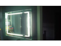 Brand new Illuminated Bathroom mirror/cabinet with de-mister and shaver point