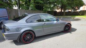 BMW grey coupe 320ci