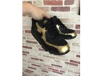 Boys black and gold nike air max