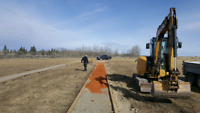 Tracked skidsteer and mini track hoes for hire