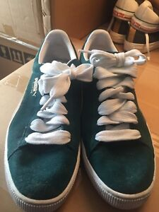 Men's size 13 Puma runners in teal