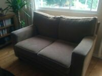 Two seater brown sofa in good condition for sale