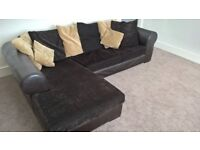 Large L shape sofa, brown leather with soft corded cushions.