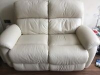 Cream leather settees