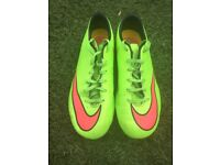 Green Nike football moulds size 5.5