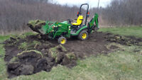 Sub-compact tractor and operator