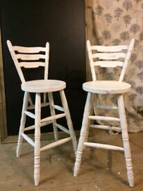 2 beautiful stools painted in luxury nymph paint with a distressed look .