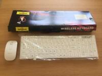 White wireless keyboard and mouse