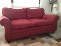Red 2 seat sofa with matching chair