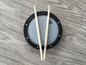 Drum pad and sticks
