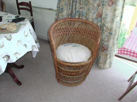 Circular wickerwork / basket weave chair with matching cushion.
