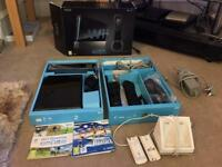 Wii Sports Resort Pack With 2 Wiimotes & 2 Recharble Batteries & Powering Station & Games