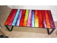Funky table with tempered glass patterned top on lightweight metal frame