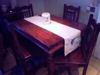 Rarely used solid indian wood table, dark wood - 4 chairs ex con very heavy solid dark wood as new