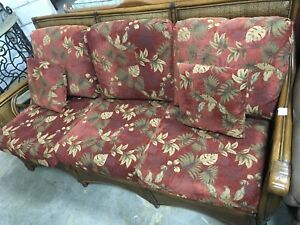 Rattan couch w/red cushions #HFHReStore