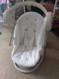 Mama and Papa electric baby swing. 5 speed settings and musical selection, lights etc