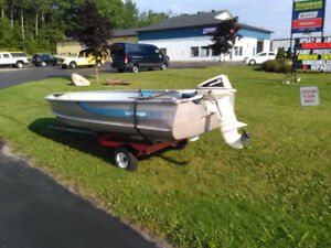 deep wide 14' w/ 9.9 Johnson and trailer