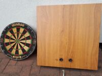 Winmau dart board and cabinet with spring loaded fixing bracket