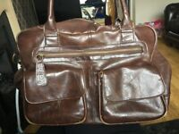 Brown boots changing bag