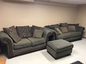 Love seat and sofa set, comes with ottoman also.