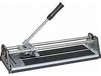tile cutter and left over white tiles