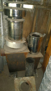 Small wood stove and pipe