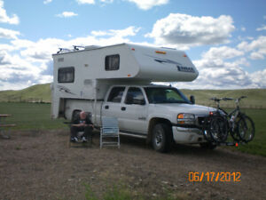 One ton GMC Truck with Lance Camper