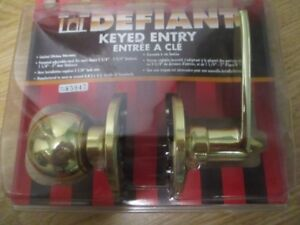 BRASS DOOR KNOB WITH KEYS.