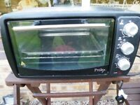 Prolex Worktop small Oven New Condition Never used, With Trays Ect,