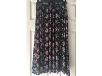 Long floral patterned skirt with 2 slits in the front (size 8)