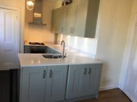 Fitted kitchen - with composite worktop