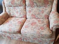 Two matching sofas, used but clean and good condition. Floral covering. Will sell separately.