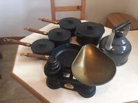 black cast iron pots, pans, scales and tea pot.
