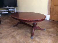 Coffee table - large oval darkish reddy brown