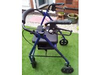 Mobility four wheel walker with seat and under seat bag