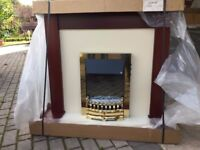 Electric fire with fire place and surround