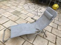 Sun lounger. Very comfy. No need for cushion.