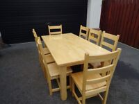 Solid wood dining room table with 8 chairs.