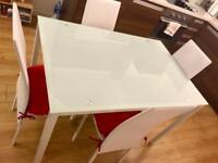 Modern glass dinner table