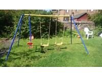 Child swing excellent condition three swings, metal frame multi coloured