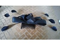Black feather and bow fascinator.