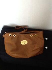 Designer style tan handbag