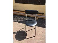 single black and silver dining or desk chair