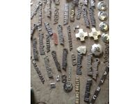 Large quantity of old car badges.