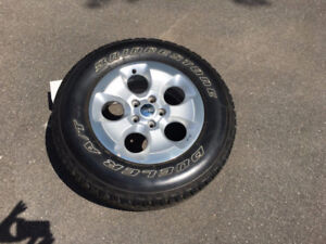 5 Wrangler Unlimited OEM Rims and Tires P255/70 R18