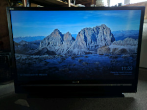 50 inch Sony Rear Projection Tv (2 HDMI ports) and Tv Stand