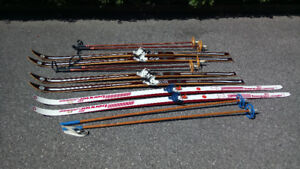 Seven sets of assorted skis and poles