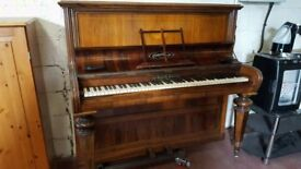 Beautiful upright piano with delivery available